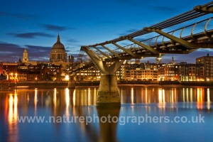 Millennium Bridge over the River Thames looking towards St Paul's Cathederal at dawn, London, Uk